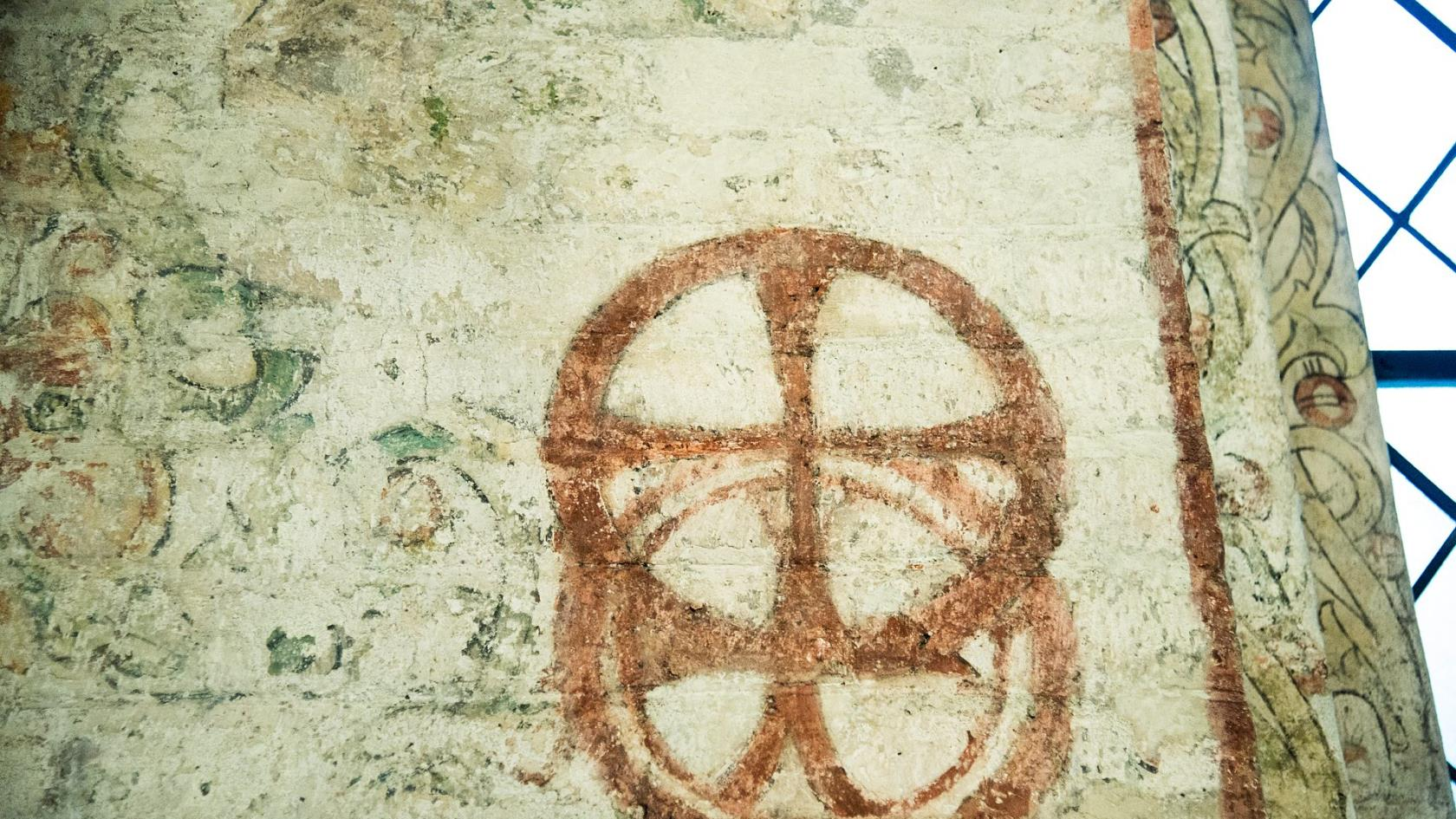 Christian symbols from long ago on a wall.