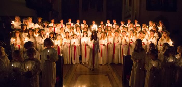 Hon kommer med ljus i sitt hår, med värme och hopp. Den 14  december 2019 firas årets Lucia.   Welcome to our annual Lucia celebration the 14th of December.