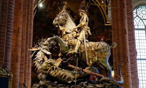 Chaplain Kristina Ljunggren tells the story about St George and the Dragon and why it is placed in Stockholm Cathedral.